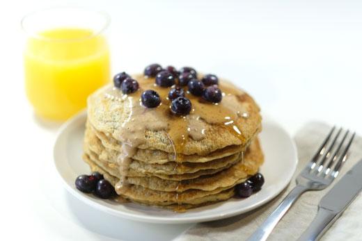healthy vegan pancakes next to a glass of orange juice