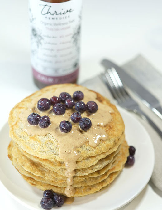 vegan pancakes with a bottle of calm tea in the background