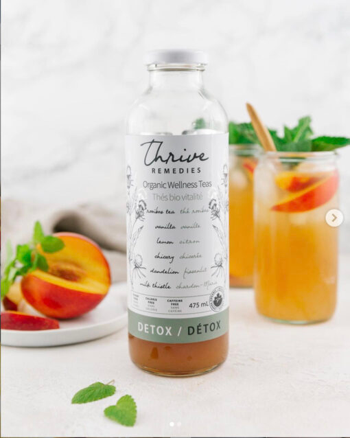 bottle of thrive remedies detox flavour with glasses of nectarine iced detox tea in the background